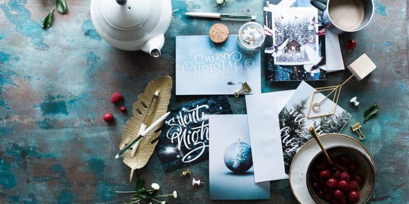 Table with Christmas cards, teapot and mug of coffee