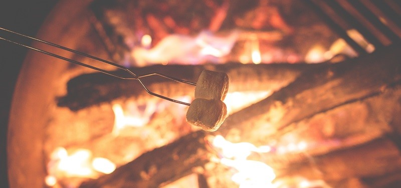 Marshmallows roasting on a firepit