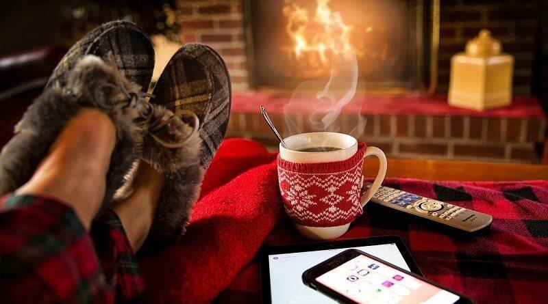 Feet in slippers, mug, fireplace