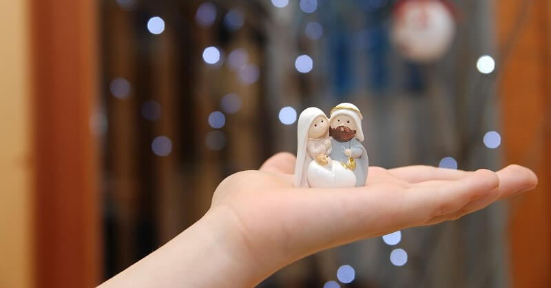 Nativity figurines in an open hand