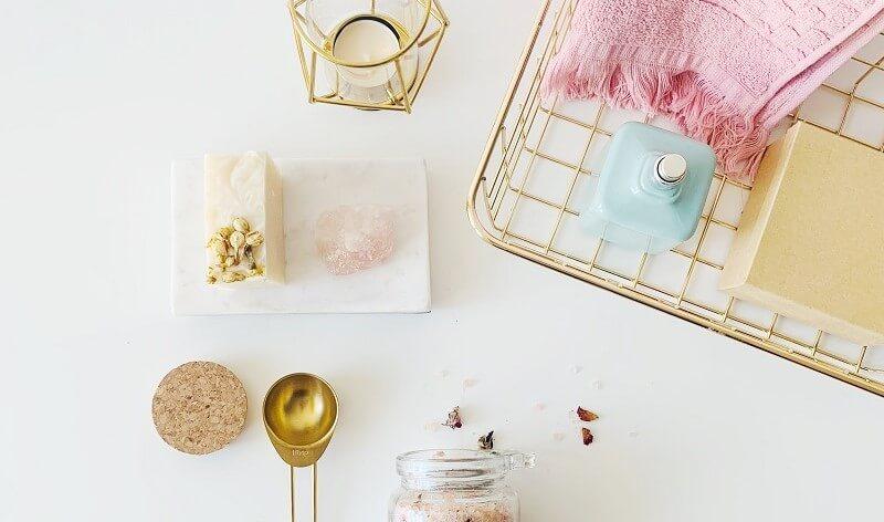 Candle, bath salts and towel
