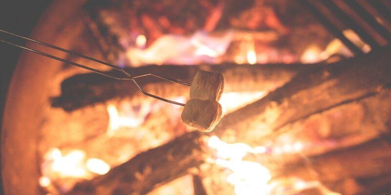Marshmallows roasting over fire for making s'mores (UK method)